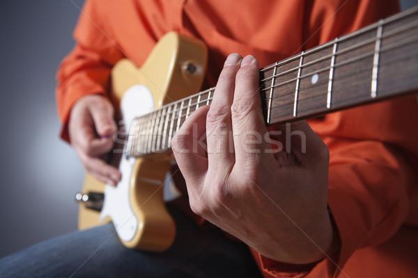 Elektromos gitár közelkép kezek zenész játszik férfi Stock fotó © courtyardpix