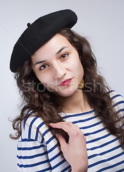 молодые красивая женщина французский стиль берет полосатый Сток-фото © courtyardpix