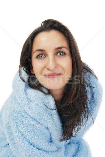 Mulher roupão de banho atraente morena azul isolado Foto stock © courtyardpix