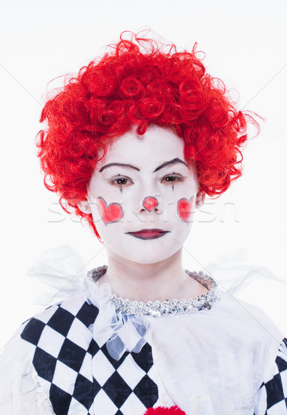 Petite fille rouge perruque posant clown maquillage Photo stock © courtyardpix