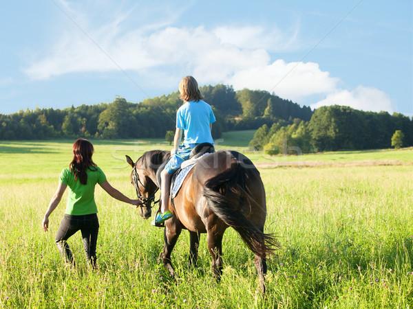 верховая езда женщину ведущий лошади мальчика Сток-фото © courtyardpix