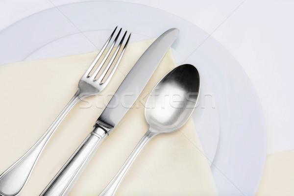 Ezüst étkészlet közelkép tányérok citromsárga ruha étel Stock fotó © courtyardpix