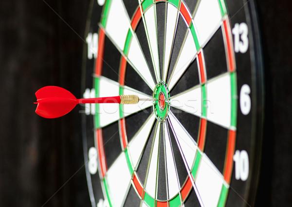 Red Dart in Bulls Eye Center of Board Stock photo © courtyardpix