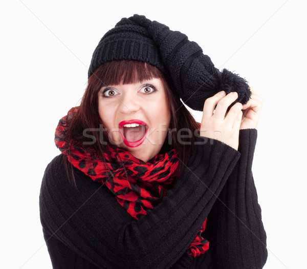 Surprised Woman in Black Cap and Red Scarf  Stock photo © courtyardpix