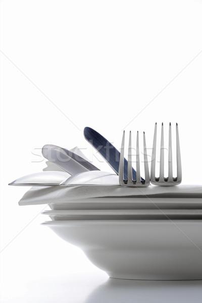 Ezüst étkészlet közelkép köteg tányérok fehér ruha Stock fotó © courtyardpix