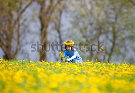 Stock photo: Boy with Blond Hair Smelling Dandelions