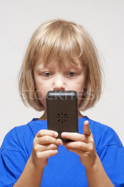 Chłopca gra komputerowa gry odizolowany świetle szary Zdjęcia stock © courtyardpix