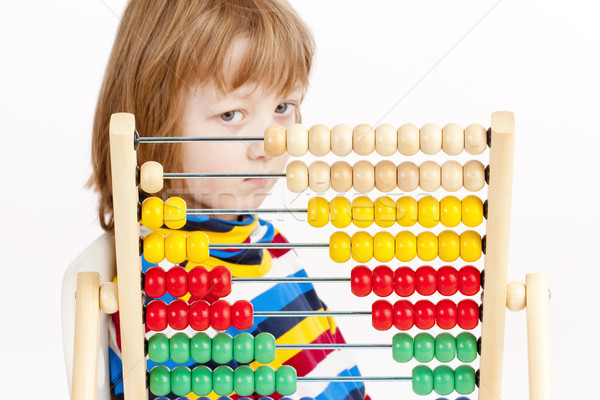 Boy Looking at Colorful Wooden Abacus Thinking  Stock photo © courtyardpix
