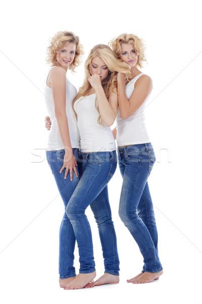 Tre giovani donne piedi isolato bianco Foto d'archivio © courtyardpix