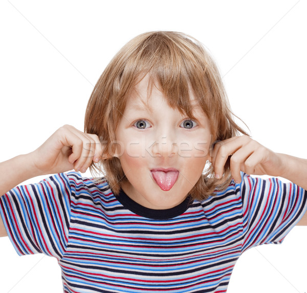 Boy with Blond Hair Sticking out his Tongue  Stock photo © courtyardpix