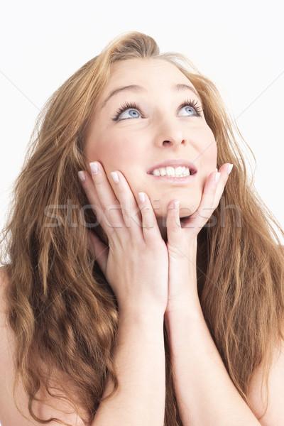Fiatal nő hosszú barna haj felfelé néz izolált fehér Stock fotó © courtyardpix