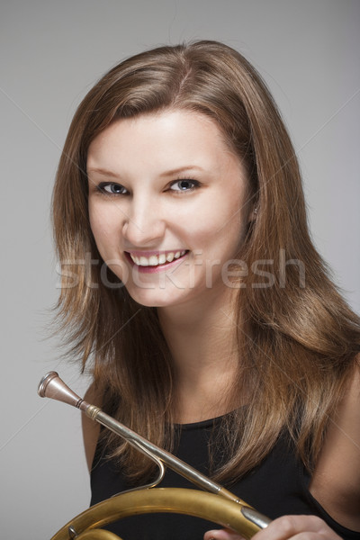 woman musician with french horn Stock photo © courtyardpix