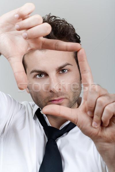 Stock fotó: Férfi · keret · ujjak · üzletember · fehér · póló