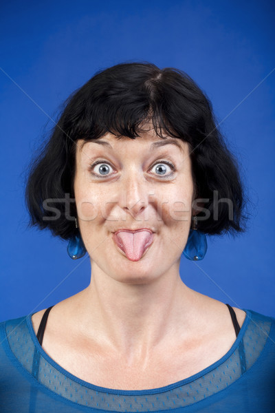 woman sticking out tongue Stock photo © courtyardpix
