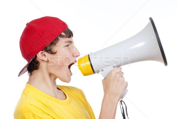 Fiú megafon tizenéves fiú piros baseballsapka kiált Stock fotó © courtyardpix