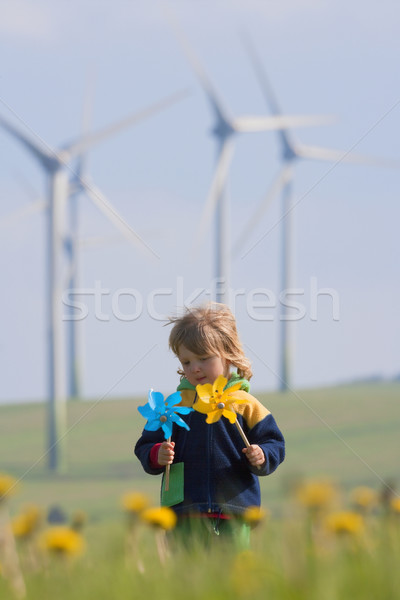 boy with pinwheel and wind farm Stock photo © courtyardpix