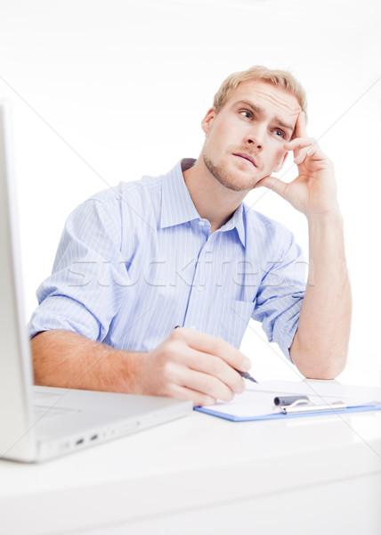 young man at office thinking Stock photo © courtyardpix