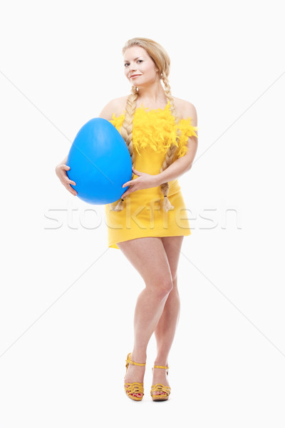 Young Woman with Long Blond Hair, Yellow Dress and Large Blue Eg Stock photo © courtyardpix