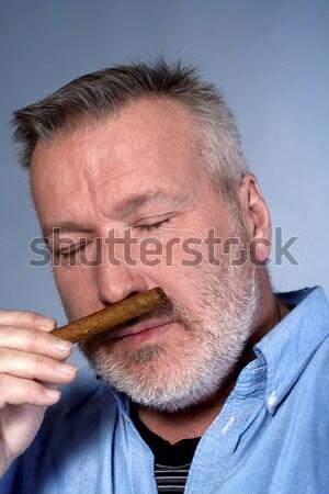 Hombre cigarro estudio retrato camisa Foto stock © courtyardpix