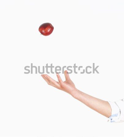 Hand Tossing Red Apple in the Air  Stock photo © courtyardpix