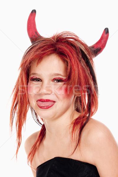 Genç kız peruk poz şeytan portre yüz Stok fotoğraf © courtyardpix