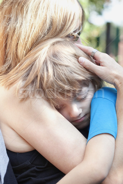 Boy Embracing his Mother, Sitting on her Lap Sleeping Stock photo © courtyardpix