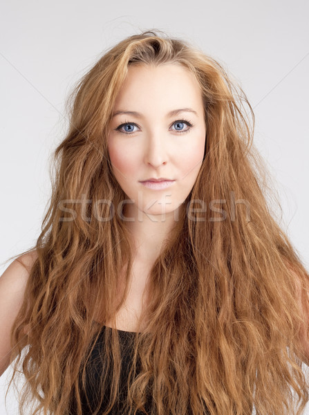 Portrait of a Young Woman with Long Brown Hair and Blue Eyes Stock photo © courtyardpix