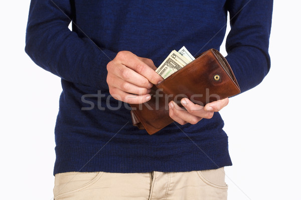 Man Holding a Wallet and Counting Dollars Stock photo © courtyardpix