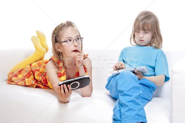 Kettő gyerekek szórakozás digitális kütyük izolált Stock fotó © courtyardpix