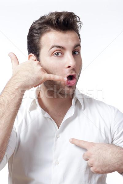 Homme appelez-moi geste shirt isolé Photo stock © courtyardpix