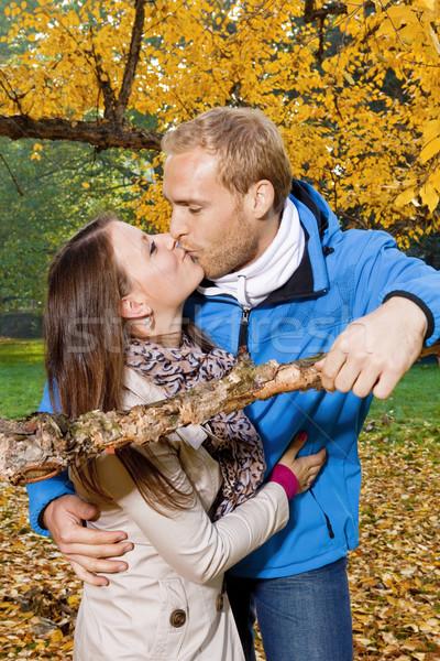 Boldog fiatal pér csók portré park nő Stock fotó © courtyardpix