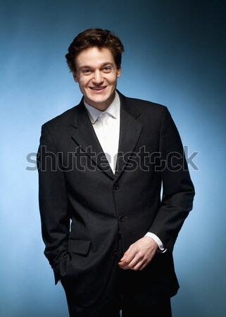 портрет молодым человеком костюм улыбка лице голову Сток-фото © courtyardpix