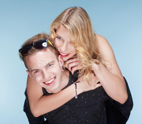 happy teenage couple piggybacking Stock photo © courtyardpix