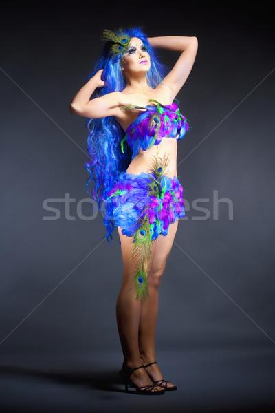 Nő kék paróka ruha tollak fiatal nő Stock fotó © courtyardpix