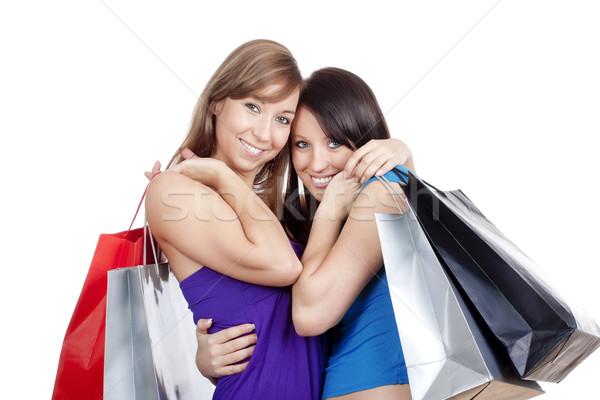Lányok bevásárlótáskák kettő boldog fiatal mosolyog Stock fotó © courtyardpix