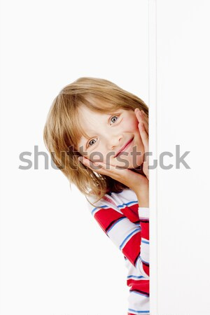 Boy Peeking Out From Behind A White Board Looking Up Stock photo © courtyardpix