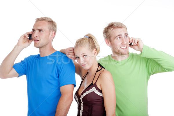 two men talking, young woman bored Stock photo © courtyardpix
