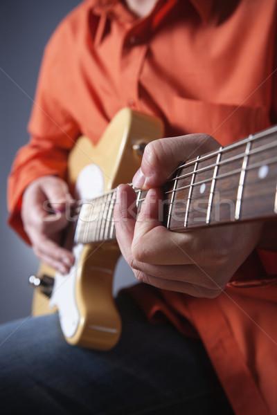 электрической гитаре рук музыканта играет человека Сток-фото © courtyardpix