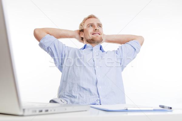 Fiatalember iroda álmodozás ül hátradőlő mosolyog Stock fotó © courtyardpix