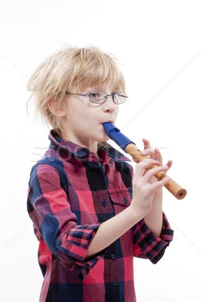 Nino flauta rubio pelo gafas jugando Foto stock © courtyardpix