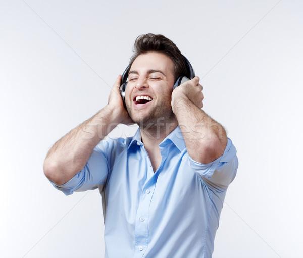 man with earphones Stock photo © courtyardpix