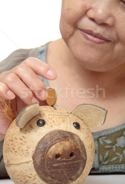 woman putting coins in small piggy bank. Selective focus, Copy s Stock photo © cozyta