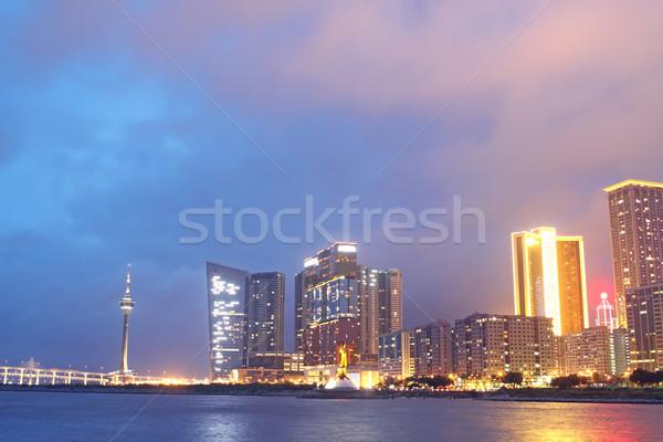 éjszaka üzlet felhők épület város hold Stock fotó © cozyta