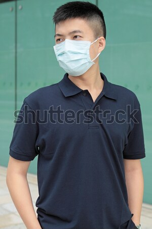 Hombre desgaste máscara aire libre ojo médicos Foto stock © cozyta