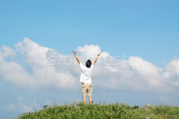Meeting of the sky. The man on high mountain with the hands lift Stock photo © cozyta