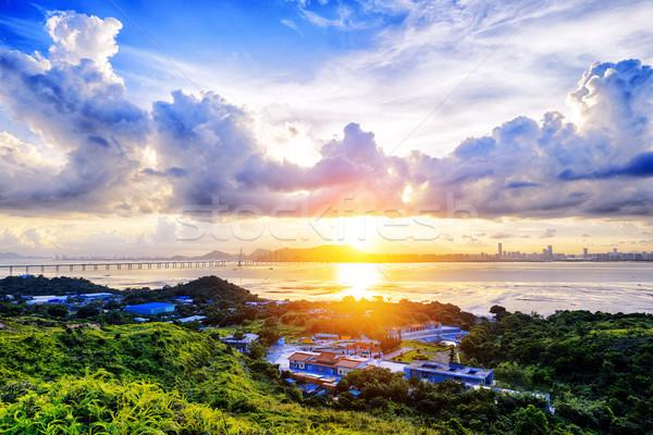 Village with beautiful sunset over hong kong  coastline.  Stock photo © cozyta