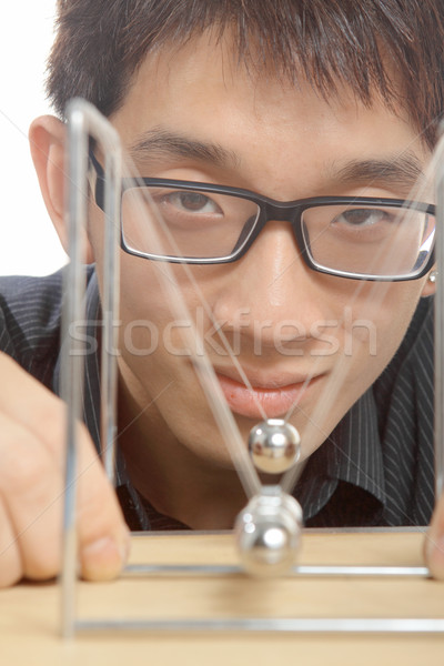 man moving Newton balls in office  Stock photo © cozyta