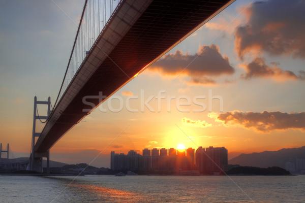 Stock fotó: Híd · naplemente · pillanat · égbolt · víz · épület