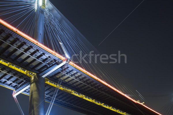 Stock photo: It is beautiful night scenes of Bridge in Hong Kong.