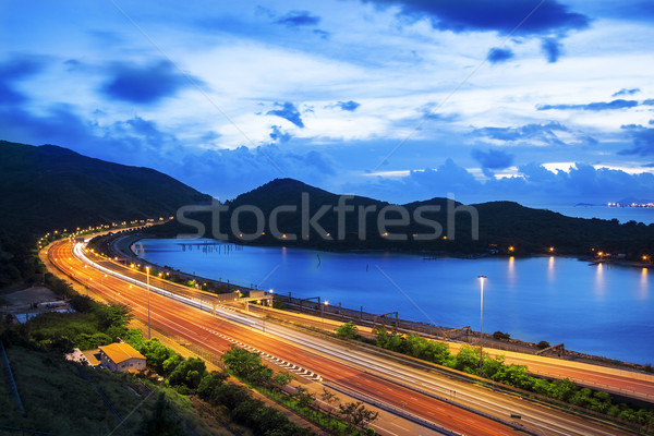 highway traffic sunset by water bay Stock photo © cozyta
